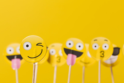 Emoji smiley social media characters on a yellow background